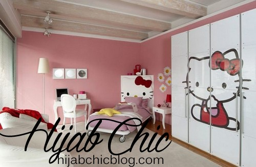 Fascinating-hello-kitty-bedroom-furniture-with-purple-bed-sheet-and-white-floor-lamp-also-desk-along-with-white-closet-and-white-rug-in-pink-wall-coloring-combine-wooden-ceiling-945x617