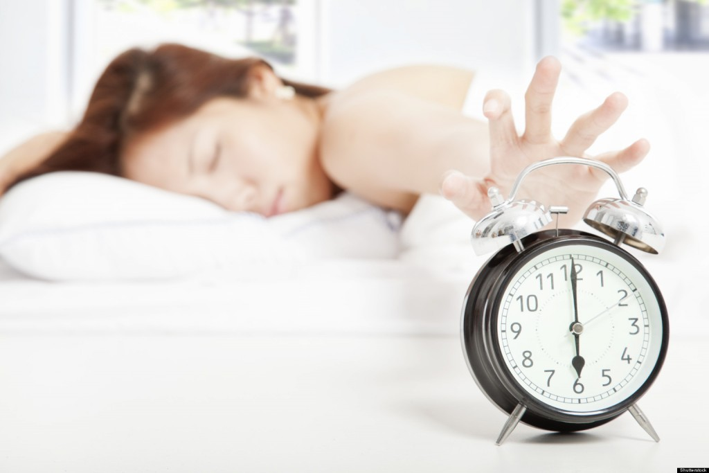 Woman turning off the alarm clock; Shutterstock ID 110605841; PO: The Huffington Post; Job: The Huffington Post; Client: The Huffington Post; Other: The Huffington Post